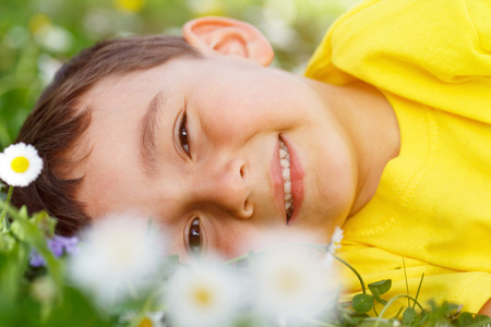 Child kid spring flower meadow flowers little boy portrait outdoor face outdoors outside nature field Banque d'images - 103923720