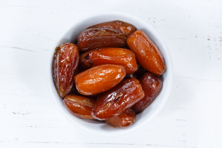 Dates fruit date from above bowl wooden board wood