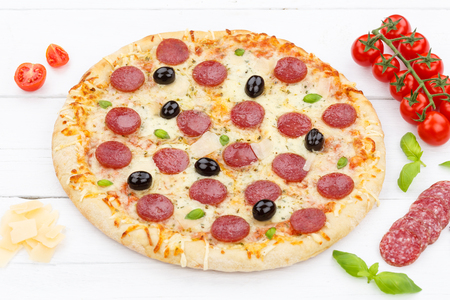 Salami pizza ingredients on wooden board wood