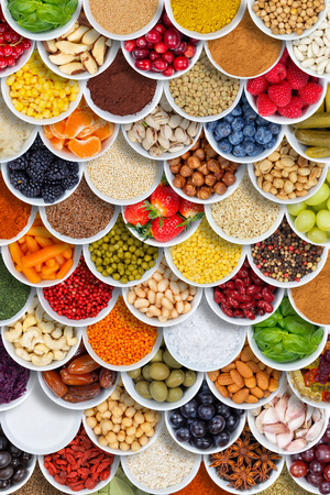 Fruits and vegetables food background spices ingredients portrait format berries from above fruit Stockfoto