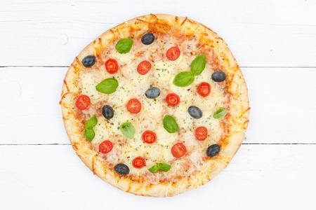 Pizza margarita margherita from above on wooden board wood Stockfoto