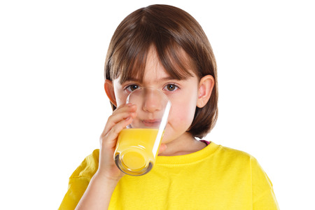 Child kid girl drinking orange juice healthy eating isolated on a white background Stockfoto