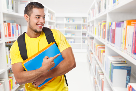 Student showing pointing marketing ad advert library learning copyspace copy space young man people learn Stockfoto