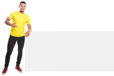 Young latin man showing pointing copyspace marketing ad advert empty blank sign isolated on a white background Stockfoto