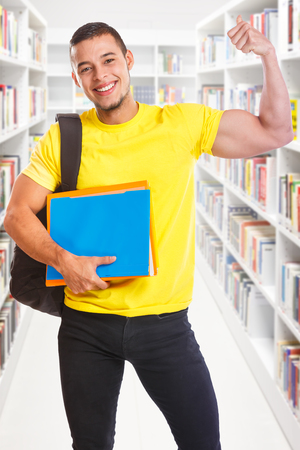 Student young man success successful portrait format strong power library education people learning