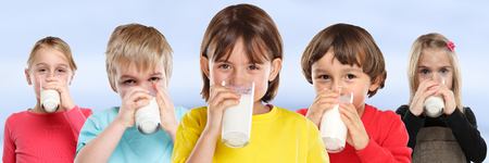 Group of children girl boy drinking milk kids glass healthy eating banner young