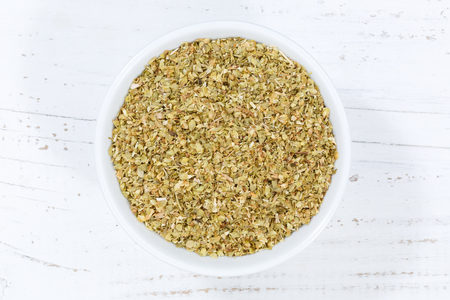 Tarragon spice herb from above bowl wooden board wood