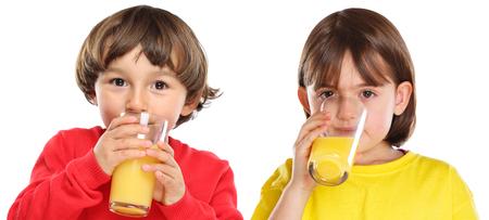 Children kids girl boy drinking orange juice healthy eating isolated on a white background Stockfoto