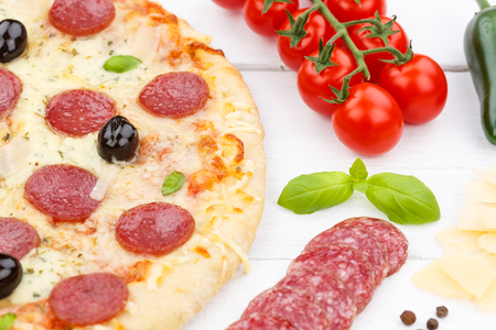 Pizza pepperoni salami baking ingredients on wooden board wood