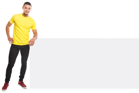 Young latin man smiling copyspace marketing ad advert empty blank sign isolated on a white background Stockfoto