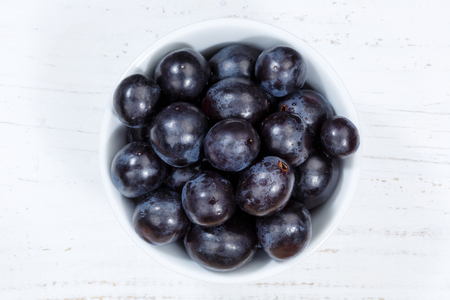 Grapes blue fruits fruit from above bowl wooden board wood