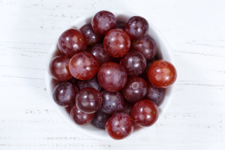 Grapes red fruits fruit from above bowl wooden board wood