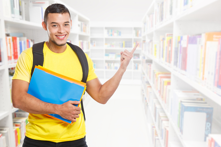 Student young man education showing pointing copyspace copy space library marketing information ad advert people learning Stockfoto