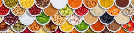Fruits and vegetables food background spices ingredients banner from above fruit