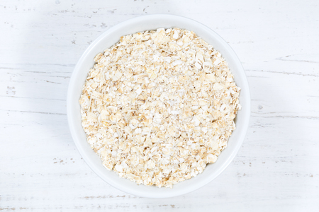 Oatmeal oats from above bowl wooden board wood