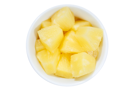 Pineapple slices fruits from above bowl isolated on a white background