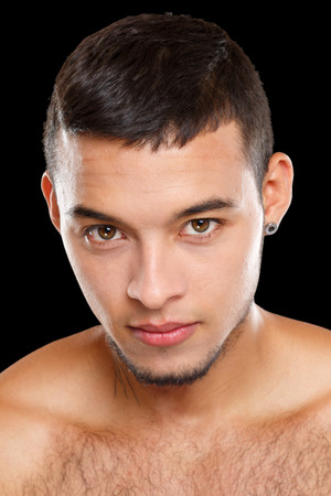 Latin handsome young man portrait people sexy look looking isolated on a black background