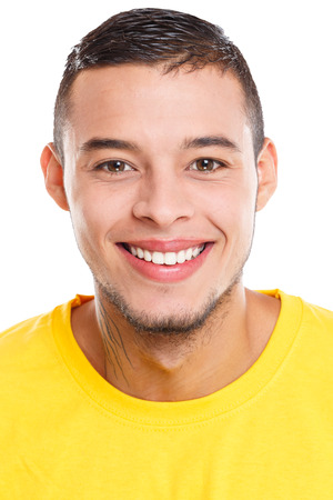 Portrait of a young latin man smiling happy people isolated on a white background