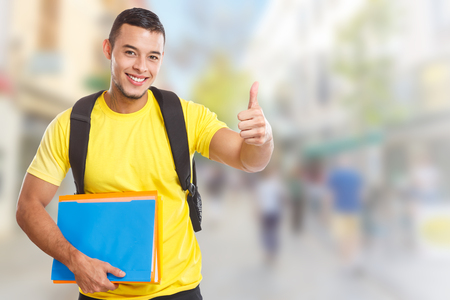 Student success successful thumbs up smiling people town copyspace copy space city