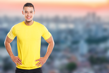 Young latin man smiling happy portrait people town copyspace copy space male