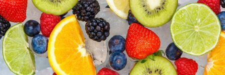Fruits berry food background banner oranges strawberries ice cubes fresh fruit backgrounds