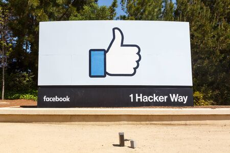 Menlo Park, California – April 10, 2019: Facebook headquarters HQ with the thumbs up like logo sign in Menlo Park, California.