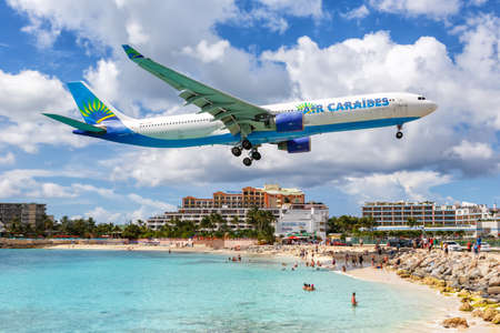 Sint Maarten – September 17, 2016: Air Caraibes Airbus A330-300 airplane at Sint Maarten airport (SXM) in Sint Maarten. Airbus is a European aircraft manufacturer based in Toulouse, France.