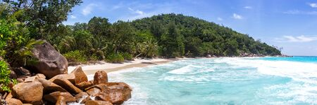 Beach Anse Georgette Praslin island Seychelles panoramic view vacation sea water