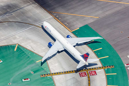 Los Angeles, California – April 14, 2019: Delta Air Lines Boeing 767-400ER airplane at Los Angeles International airport (LAX) in California. Boeing is an American aircraft manufacturer headquartered in Chicago.