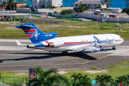 Sint Maarten, Netherland Antilles – September 20, 2016: AmeriJet International Boeing 727-200F airplane at Sint Maarten airport (SXM) in the Netherland Antilles.