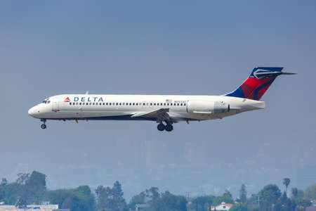 Los Angeles, California – April 14, 2019: Delta Air Lines Boeing 717-200 airplane at Los Angeles International airport (LAX) in California. Boeing is an American aircraft manufacturer headquartered in Chicago.