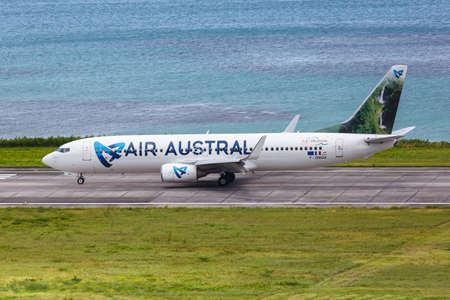 Mahe, Seychelles - February 9, 2020: Air Austral Boeing 737-800 airplane at Mahe airport (SEZ) in the Seychelles. Boeing is an American aircraft manufacturer headquartered in Chicago.