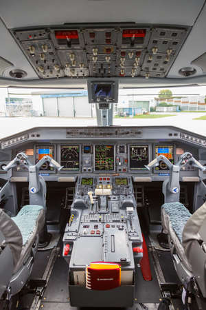 Cologne, Germany - November 2, 2019: German Airways Embraer 190 airplane cockpit at Cologne Koeln Bonn Airport (CGN) in Germany.