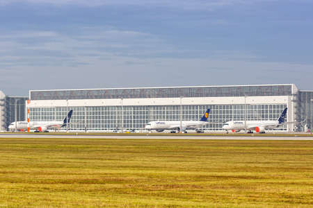 Munich, Germany - October 21, 2020: Stored Lufthansa Airbus A350 airplanes at Munich Airport (MUC) in Germany. 新闻类图片