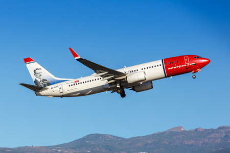 Tenerife, Spain - November 26, 2019: Norwegian Boeing 737-800 airplane at Tenerife South Airport in Spain. Boeing is an American aircraft manufacturer headquartered in Chicago.