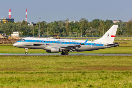 Warsaw, Poland - May 26, 2019: LOT Polskie Linie Lotnicze Embraer 175 airplane in the Retro livery at Warsaw Warszawa Airport (WAW) in Poland.