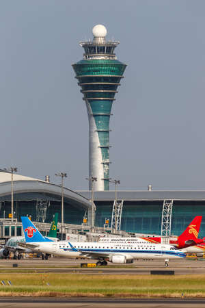 Guangzhou, China - September 23, 2019: China Southern Airlines Embraer 190 airplane at Guangzhou Baiyun Airport (CAN) in China.