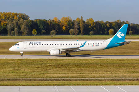 Munich, Germany - October 21, 2020: Air Dolomiti Embraer ERJ 195 airplane at Munich Airport (MUC) in Germany.