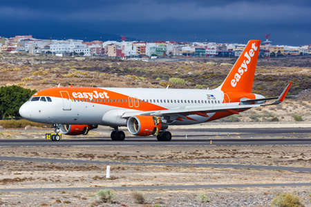 Tenerife, Spain - November 23, 2019: EasyJet Europe Airbus A320 airplane at Tenerife South Airport in Spain. Airbus is a European aircraft manufacturer based in Toulouse, France.