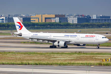 Guangzhou, China - September 24, 2019: China Eastern Airlines Airbus A330-300 airplane at Guangzhou Baiyun Airport (CAN) in China.