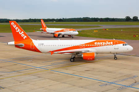 Luton, United Kingdom - July 8, 2019: EasyJet Airbus A320 airplanes at London Luton Airport in the United Kingdom. Airbus is a European aircraft manufacturer based in Toulouse, France. 新闻类图片