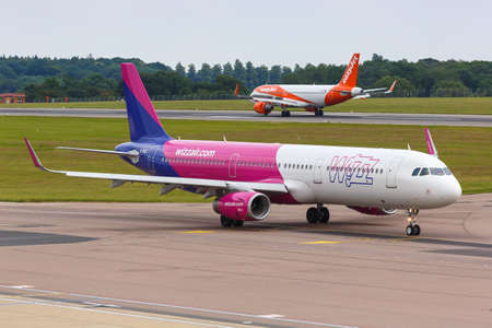 Luton, United Kingdom - July 8, 2019: Wizzair UK Airbus A321 airplane at London Luton Airport in the United Kingdom.