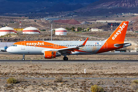 Tenerife, Spain - November 23, 2019: EasyJet Europe Airbus A320 airplane with 20 Years special colors at Tenerife South Airport in Spain. 新闻类图片