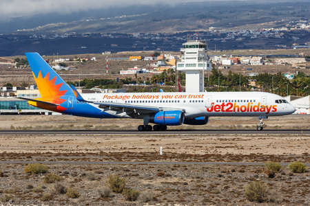 Tenerife, Spain - November 23, 2019: Jet2 Boeing 757-200 airplane at Tenerife South Airport in Spain. Boeing is an American aircraft manufacturer headquartered in Chicago.