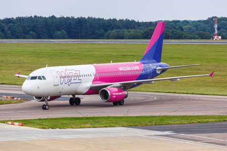 Luton, United Kingdom - July 8, 2019: Wizzair Airbus A320 airplane at London Luton Airport in the United Kingdom. Airbus is a European aircraft manufacturer based in Toulouse, France.