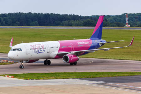 Luton, United Kingdom - July 8, 2019: Wizzair Airbus A321 airplane at London Luton Airport in the United Kingdom. Airbus is a European aircraft manufacturer based in Toulouse, France.