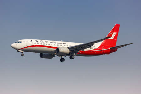 Shanghai, China - September 28, 2019: Shanghai Airlines Boeing 737-800 airplane at Shanghai Hongqiao Airport in China. Boeing is an American aircraft manufacturer headquartered in Chicago. 新闻类图片