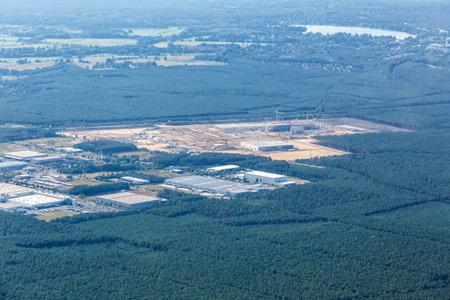 Berlin, Germany - August 19, 2020: Tesla Gigafactory Berlin Brandenburg Giga Factory construction site aerial view photo in Germany.