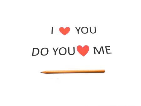 Note I LOVE YOU sentence words written on white paper with a brown wood pencil.