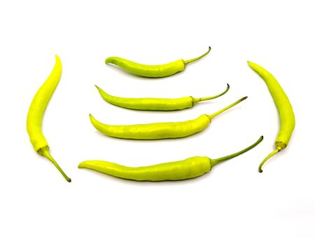 pile of Northern Thai Green Chilli or capsicum or Cayenne Pepper or bell pepper on white background.